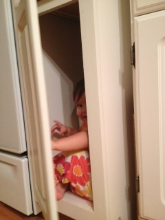 Emma Playing in the Cabinets